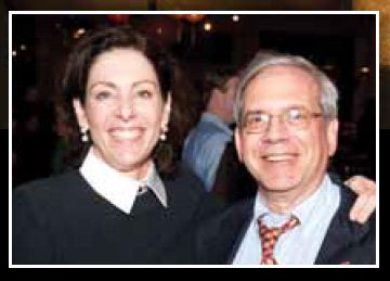 (Wife of David Gregory with D.C. Attorney General Irvin Nathan at charity event)
