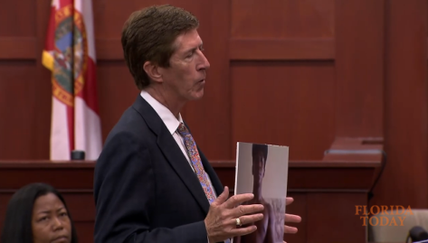 Mark OMara shows cell phone photo of Trayvon Martin