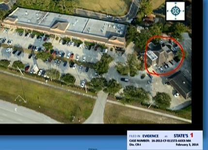 (Plaza parking lot, gas station circled.)