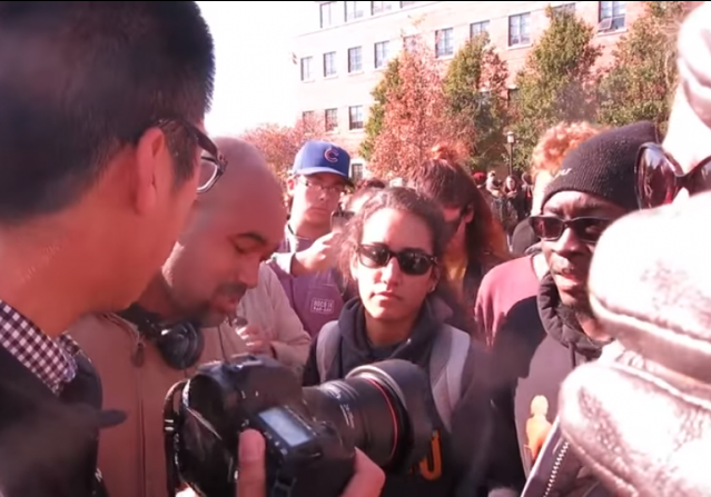 [U. Missouri Protesters confront student journalist]