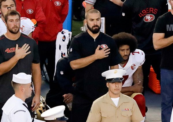 https://pmchollywoodlife.files.wordpress.com/2016/08/colin-kaepernick-jeremy-lane-sitting-national-anthem-3.jpg?w=600