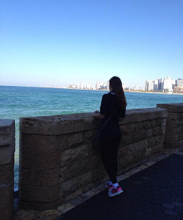 Mirit Hadar at sea wall Israel